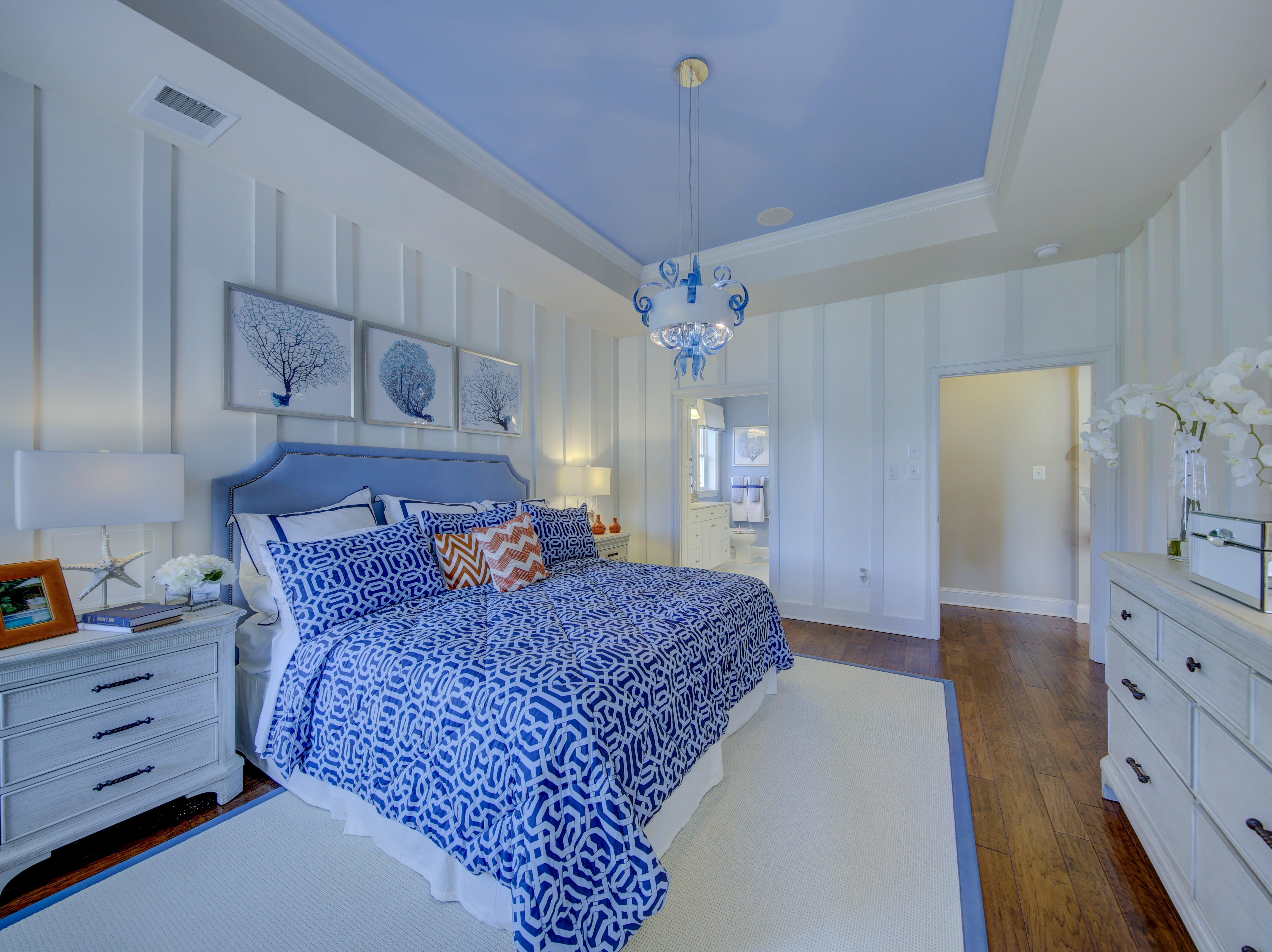 The master bedroom of the model home at The Overlook in Selbyville features a tray ceiling and moulding on the wall.