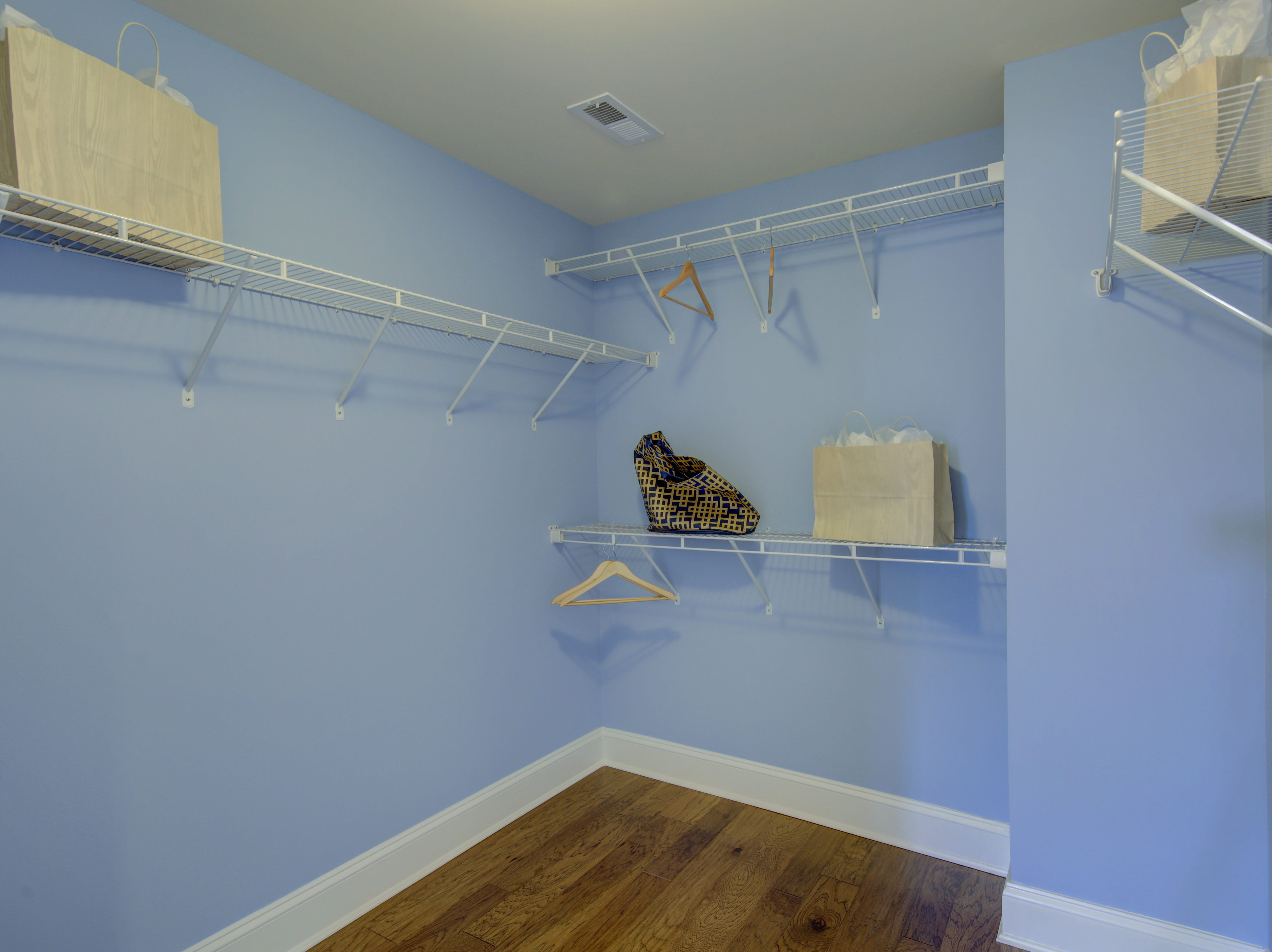 The walk-in closet of the master bedroom in the model home of The Overlook in Selbyville offers lots of his and her space.
