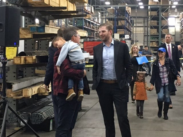 Eric Trump, right, talks with U.S. Rep. Sean Duffy at G3 Industries in Kronenwetter on Tuesday, Oct. 30, 2018.