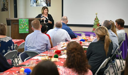 Karen DeWitt, a chaplain for Hospice of Wichita Falls, speaks to members of the media Tuesday about the Hospice Tree of Lights campaign and how purchase a light in honor of or in memory of a loved one.