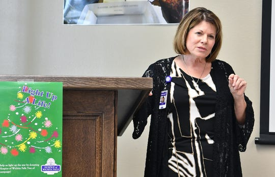 In this file photo, Karen DeWitt, a chaplain for Hospice of Wichita Falls, talks about the Hospice Tree of Lights campaign and how purchase a light in honor of, or in memory of, a loved one.