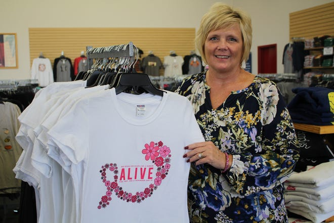 Julie Biles and 5Bs donated shirts to breast cancer survivors and patients during Breast Cancer Awareness Month.