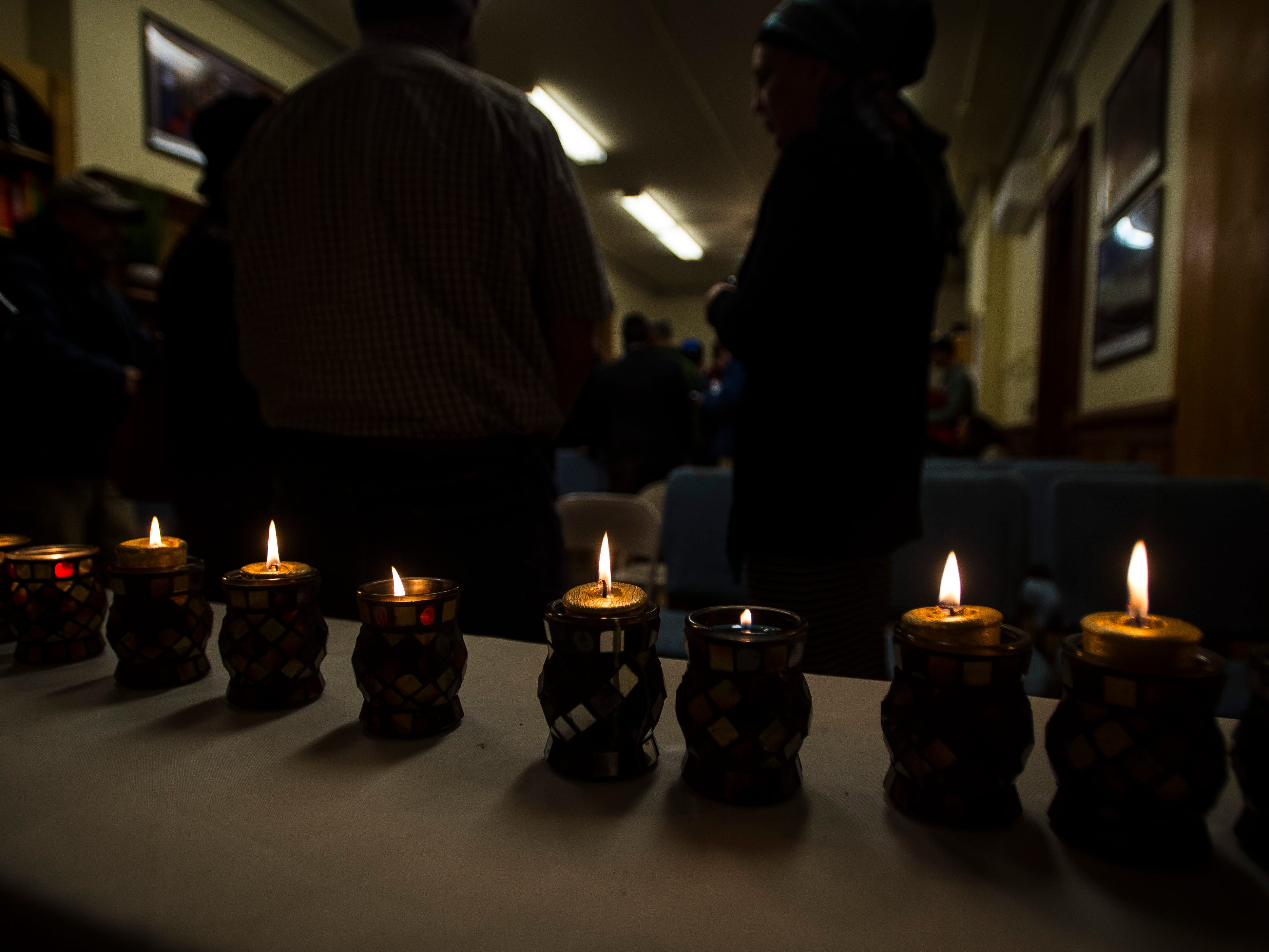 Eleven candles, one marking each life of the people killed at the Tree of Life Congregation Synagogue in the Squirrel Hill neighborhood of Pittsburgh, were lit during a vigil at Chabad of Vermont in Burlington, Vt., Monday, Oct. 29, 2018.