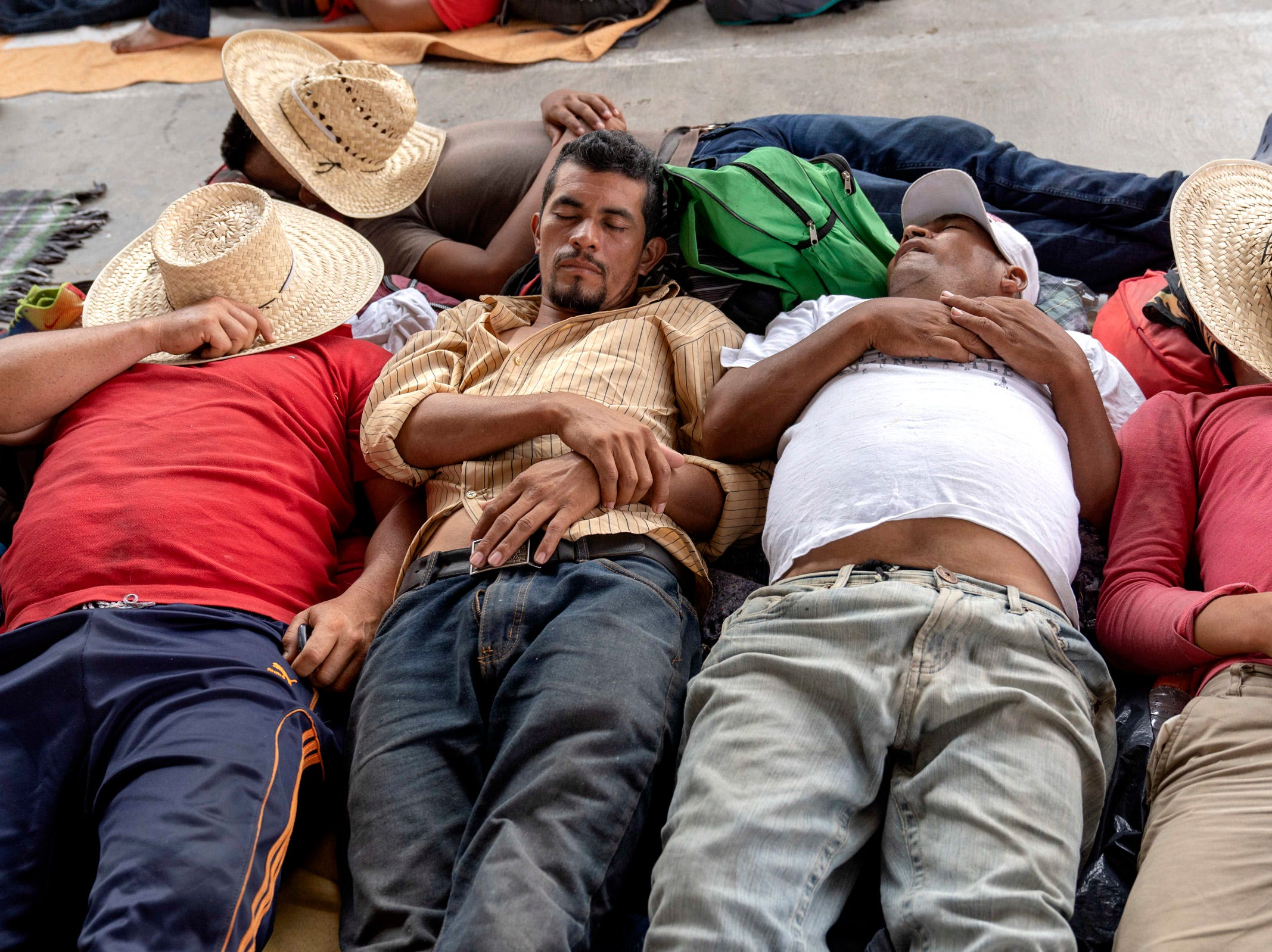 Migrants from Honduras and other Central American countries traveling in a caravan headed for the U.S. rest in the town of Santiago Niltepec in the state of Oaxaca.