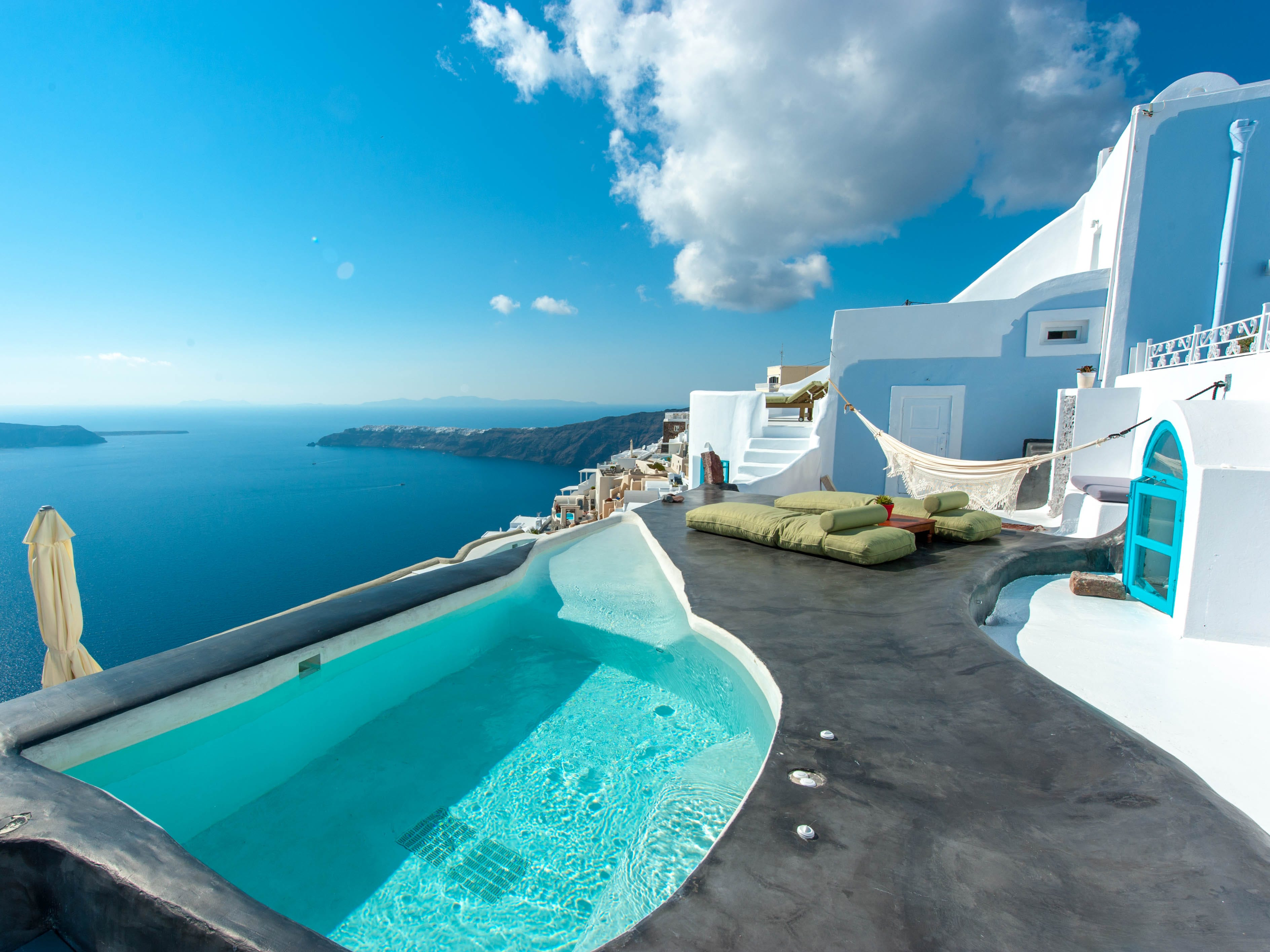 Sophia Luxury Suites, Santorini: Sophia Luxury Suites is set on the hillside in the heart of Imerovigli – the highest point of Santorini – meaning it has some of the best views around, plus a quieter vibe than busy Oia or Fira. Each room has its own balcony or terrace with a plunge pool or hot tub (aside from the Character Cave Rooms, which have indoor plunge pools instead) and stunning views out to the ocean, the caldera and scenic Skaros Rock.