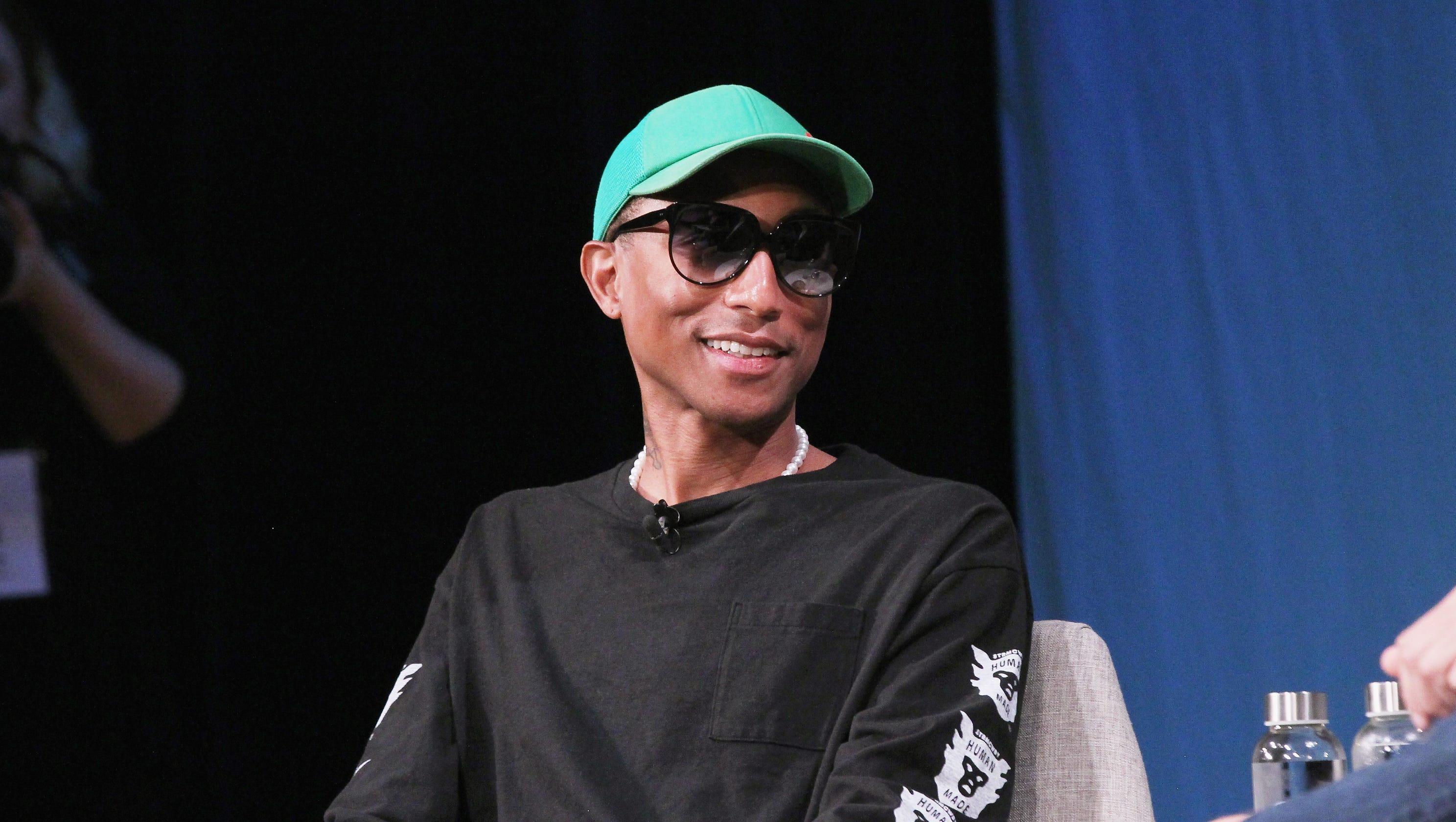 54c514545 Pharrell Williams threatens to sue Trump for using  Happy