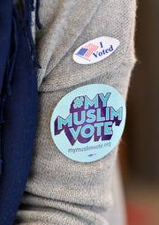 "Kasar Abdulla wears an ""I voted"" and ""#MyMuslimVote"" sticker after early voting at Casa Azafran for a ""Vote Together Party"" hosted by the American Muslim Advisory Council Friday, Oct. 26, 2018, in Nashville, Tenn."