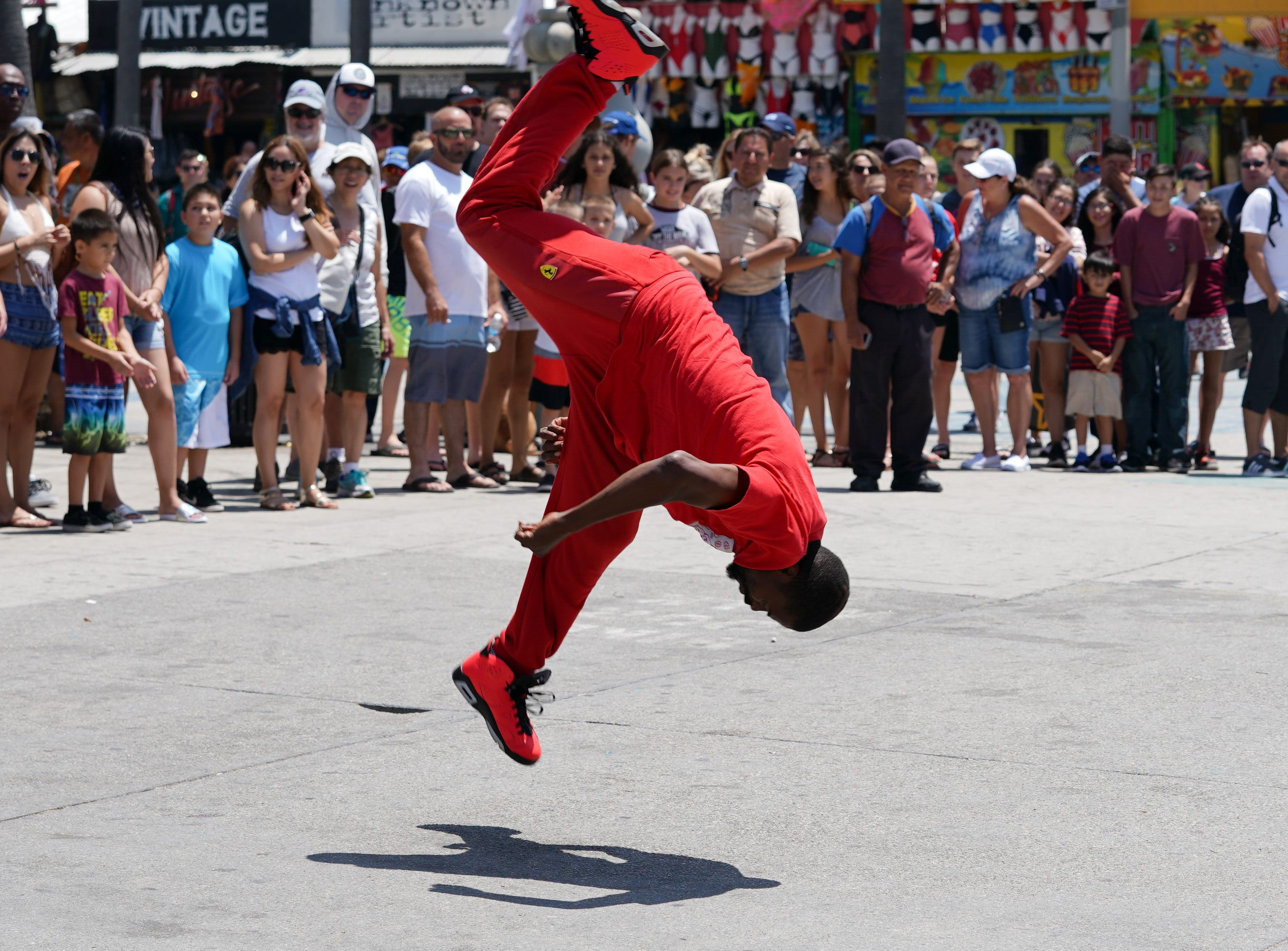 A street performer does acrobatics in Venice Beach.