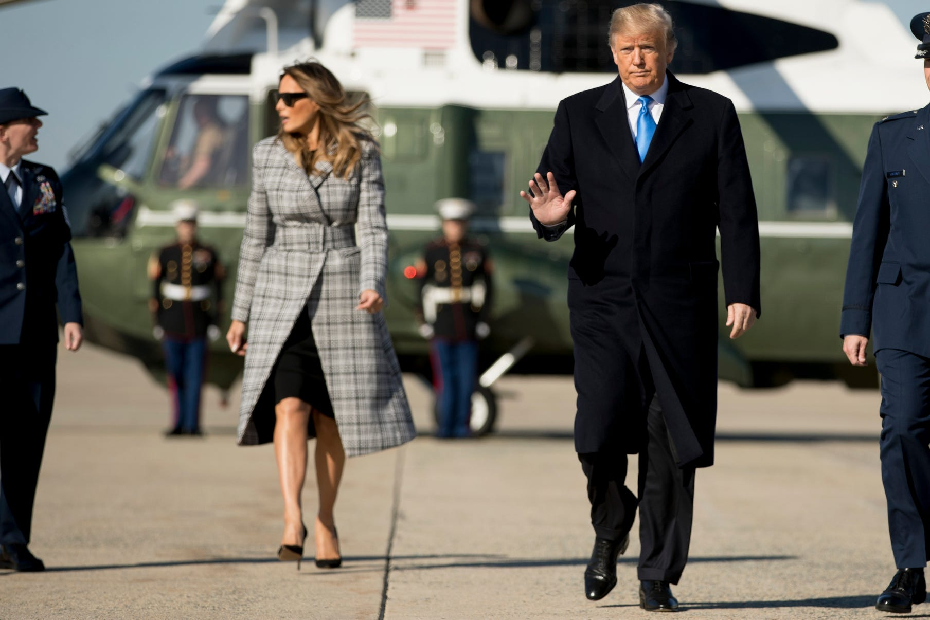 President Donald Trump waves to members of the media as he and the First Lady board Air Force One at Andrews Air Force Base, Md., to travel to Pittsburgh.