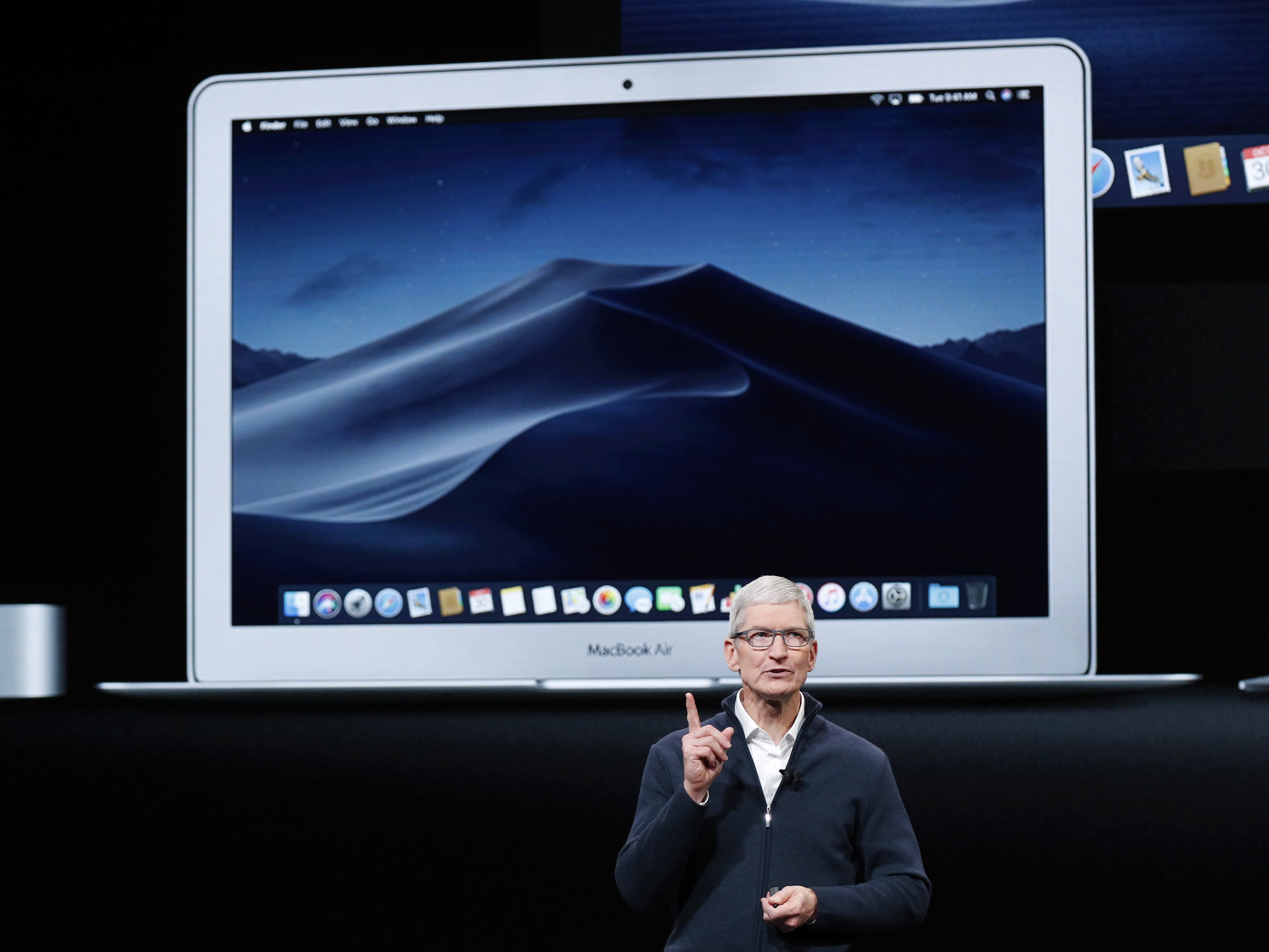 Apple CEO Tim Cook speaks with a MacBook Air behind him during an Apple special event at the Howard Gilman Opera House at the Brooklyn Academy of Music before the start of an Apple event in New York, Tuesday, Oct. 30, 2018.
