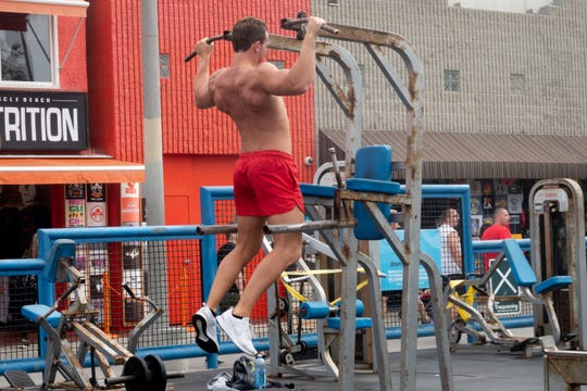 Working out in Muscle Beach.
