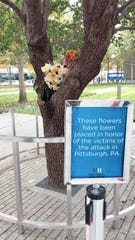 Flowers at 9/11 Memorial in New York are place in honor of the victims of the victims of the attack in Pittsburgh.
