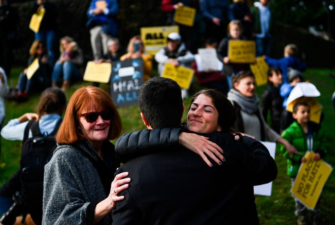 Protesters hug near the Tree of Life Congregation on October 30, 2018, in Pittsburgh, Pennsylvania.