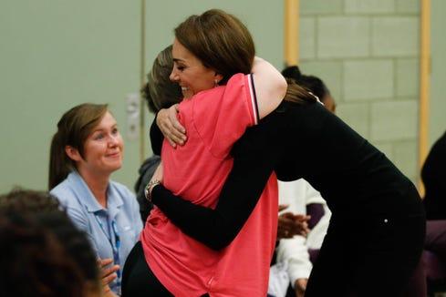 Duchess Kate hugs a Coach Core Essex participant.