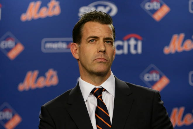New Mets GM Brodie Van Wagenen listens to questions during an introductory news conference on Tuesday.
