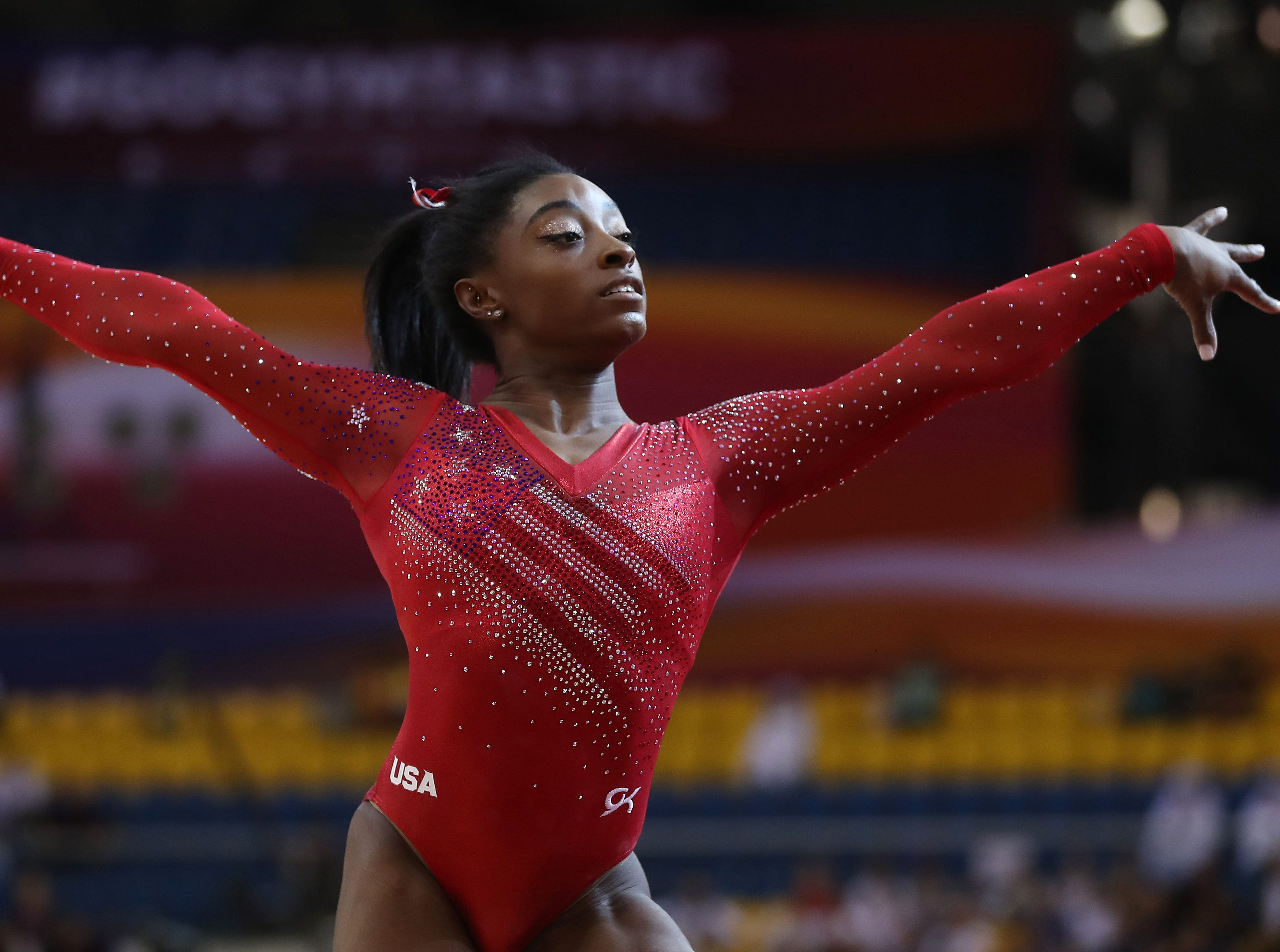 Simone Biles competes in the women's floor during women's team final of the 2018 FIG Artistic Gymnastics Championships at Aspire Dome on Oct. 30 in Doha, Qatar. The Americans won their fourth consecutive gold at worlds.