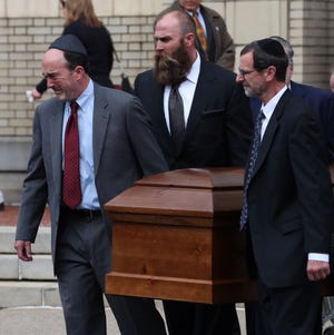 One of the caskets for David and Cecil Rosenthal is carried out of the the Rodef Shalom Congregation synagogue Oct. 30, 2018, at the conclusion of the funeral in Pittsburgh. The brothers were killed Oct. 27 as they prepared for worship at the nearby Tree of Life Synagogue where 11 were slain.