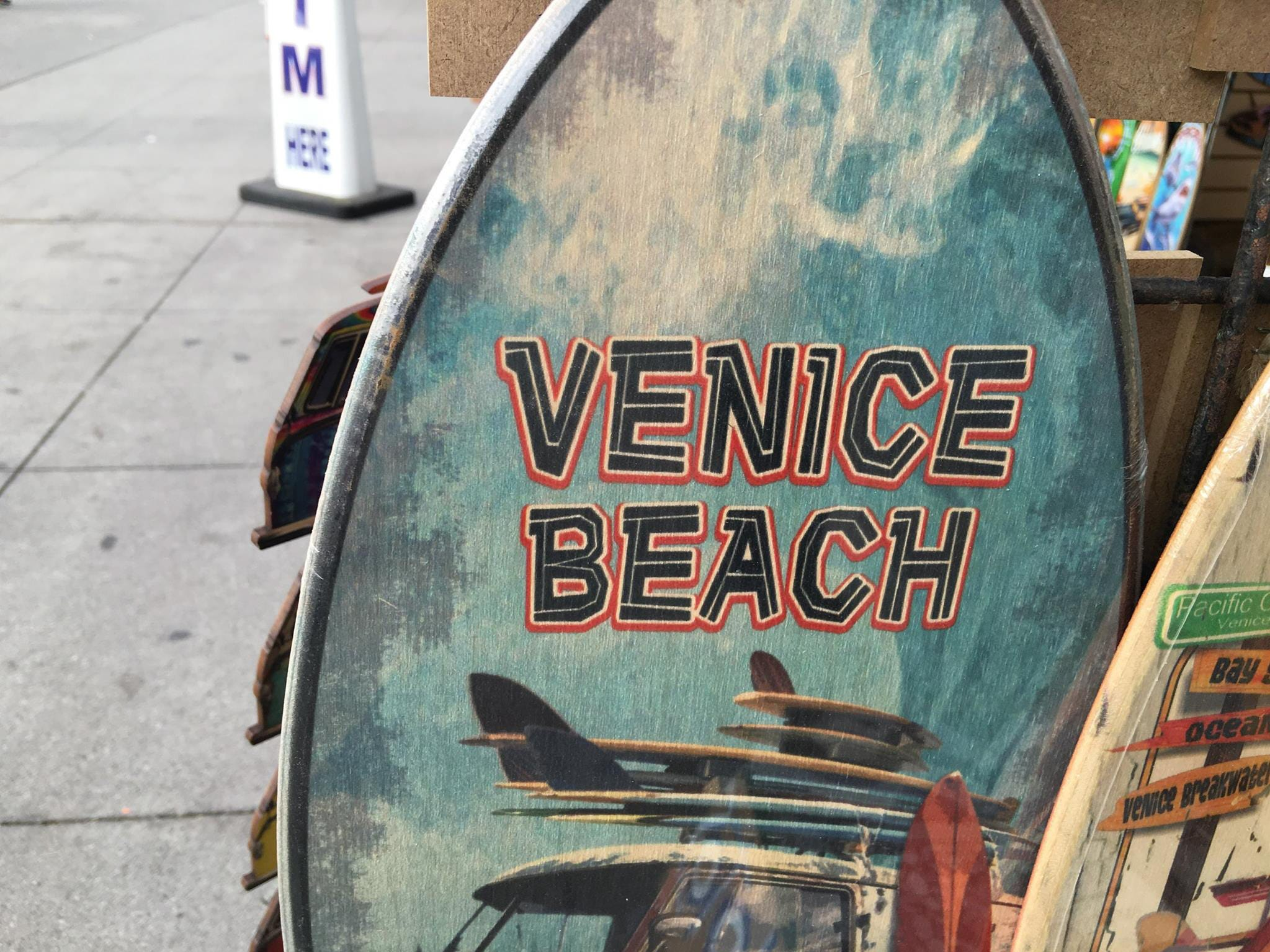A Venice Beach painted surfboard for sale.