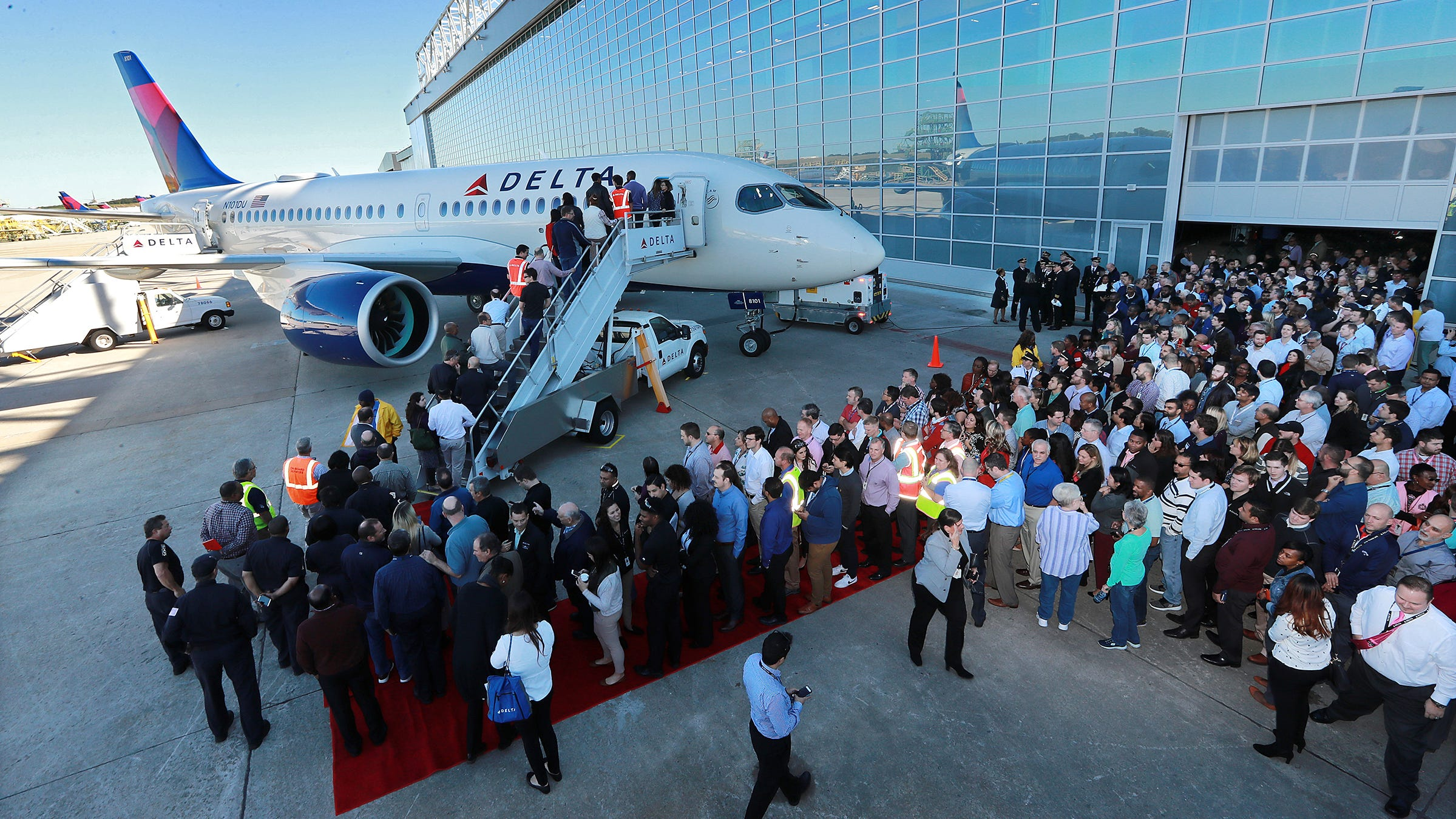 Delta employees and guests tour the new A220 aircraft during an unveiling at the Delta Air Lines TechOps on Oct. 29, 2018, in Atlanta.