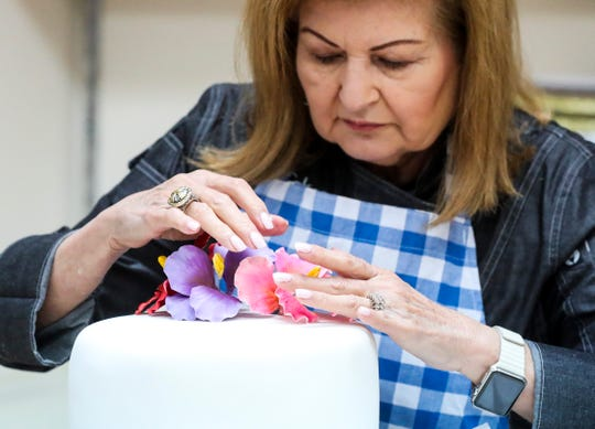Nina Torres, the owner of Cakes Plus in Tampa, Florida, is known for her sugar flowers that are made by hand. Not only does she add them to her own cakes, she sells them to other cake makers.