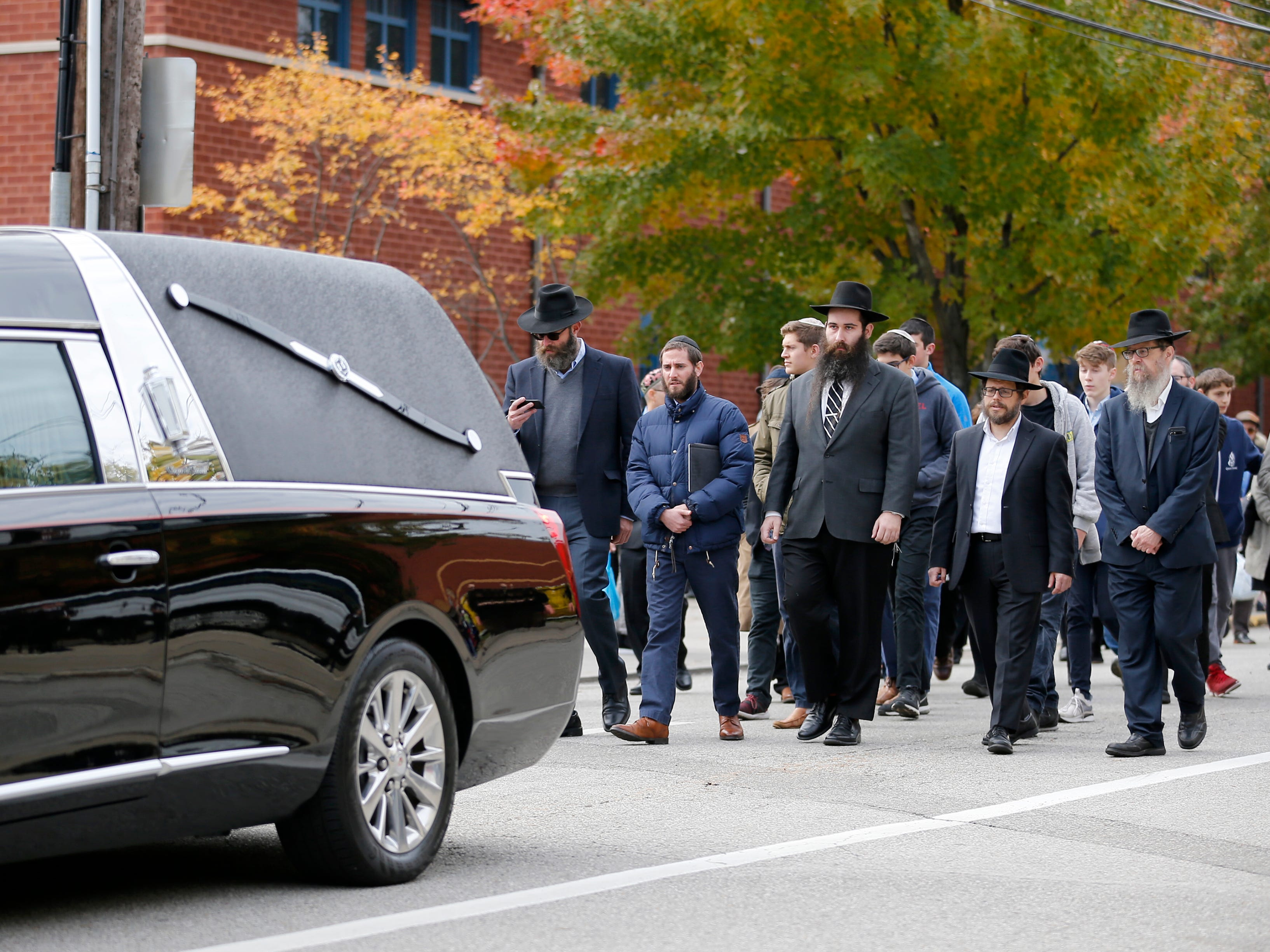 A processional leaves the Jewish Community Center after the funeral of Dr. Jerry Rabinowitz, 66, in the Squirrel Hill neighborhood of Pittsburgh, Oct. 30, 2018. Rabinowitz and 10 other people were shot and killed Oct. 27, 2018 during a service at Tree of Life Congregation Synagogue in Pittsburgh.   Robert Bowers allegedly screamed anti-Semitic epithets, as he opened fire on the congregants, law enforcement officials said. Eleven worshippers were killed and six other people were wounded.