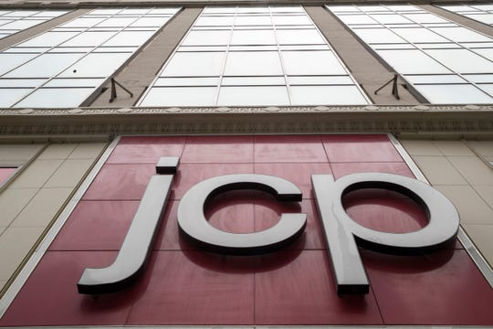 FILE - In this May 16, 2018, photo, the J.C. Penney logo hangs outside the Manhattan Mall in New York. J.C. Penney has named Jill Soltau, who most recently served as president and CEO of fabric and crafts chain Jo-Ann Stores, to be its next CEO, effective Oct. 15, 2018. (AP Photo/Mary Altaffer, File) ORG XMIT: NYSB221