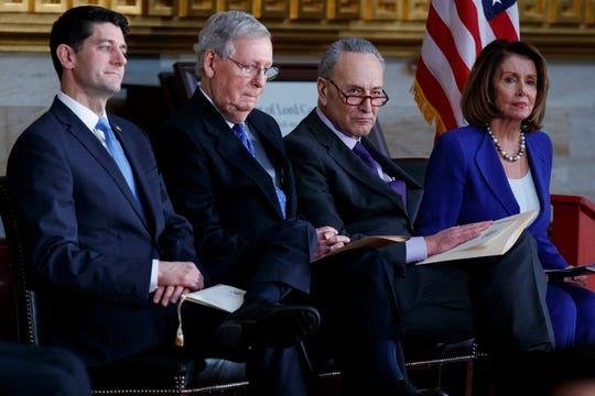 Speaker of the House Rep. Paul Ryan, R-Wis., Senate Majority Leader Mitch McConnell, R-Ky., Senate Minority Leader Chuck Schumer, D-N.Y., and House Minority Leader Rep. Nancy Pelosi, D-Calif., listen as President Donald Trump speaks during a Congressional Gold Medal ceremony honoring former Senator Bob Dole on Capitol Hill, Wednesday, Jan. 17, 2018, in Washington.
