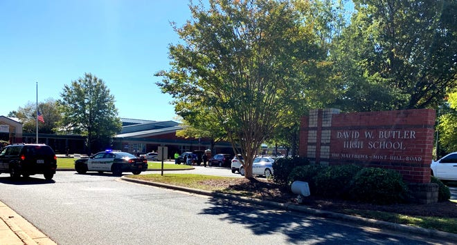 Emergency personnel respond to a shooting at Butler High School in Matthews, N.C., on Oct. 29. A student shot and killed a fellow student during a fight in a crowded school hallway Monday, officials said, prompting a lockdown.