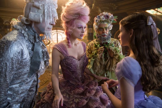 "Shiver (Richard E. Grant), the Sugar Plum Fairy (Keira Knightley) and Hawthorne (Eugenio Derbez) give the lay of the lands to Clara (Mackenzie Foy) in ""The Nutcracker and the Four Realms."""