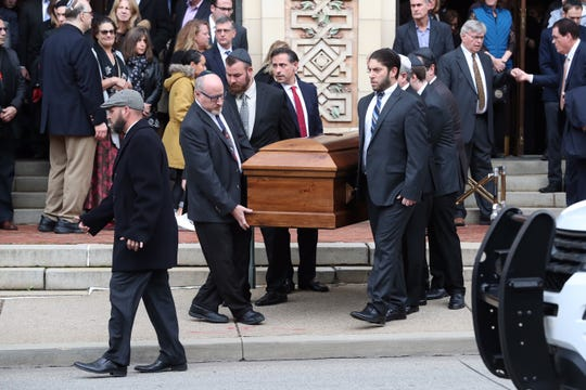 Pallbearers carry one of the caskets for brothers David and Cecil Rosenthal, killed three days before in the worst mass killing in U.S. history of worshipping Jews, after their funeral Oct. 30, 2018, at the Rodef Shalom Congregation synagogue in Pittsburgh.