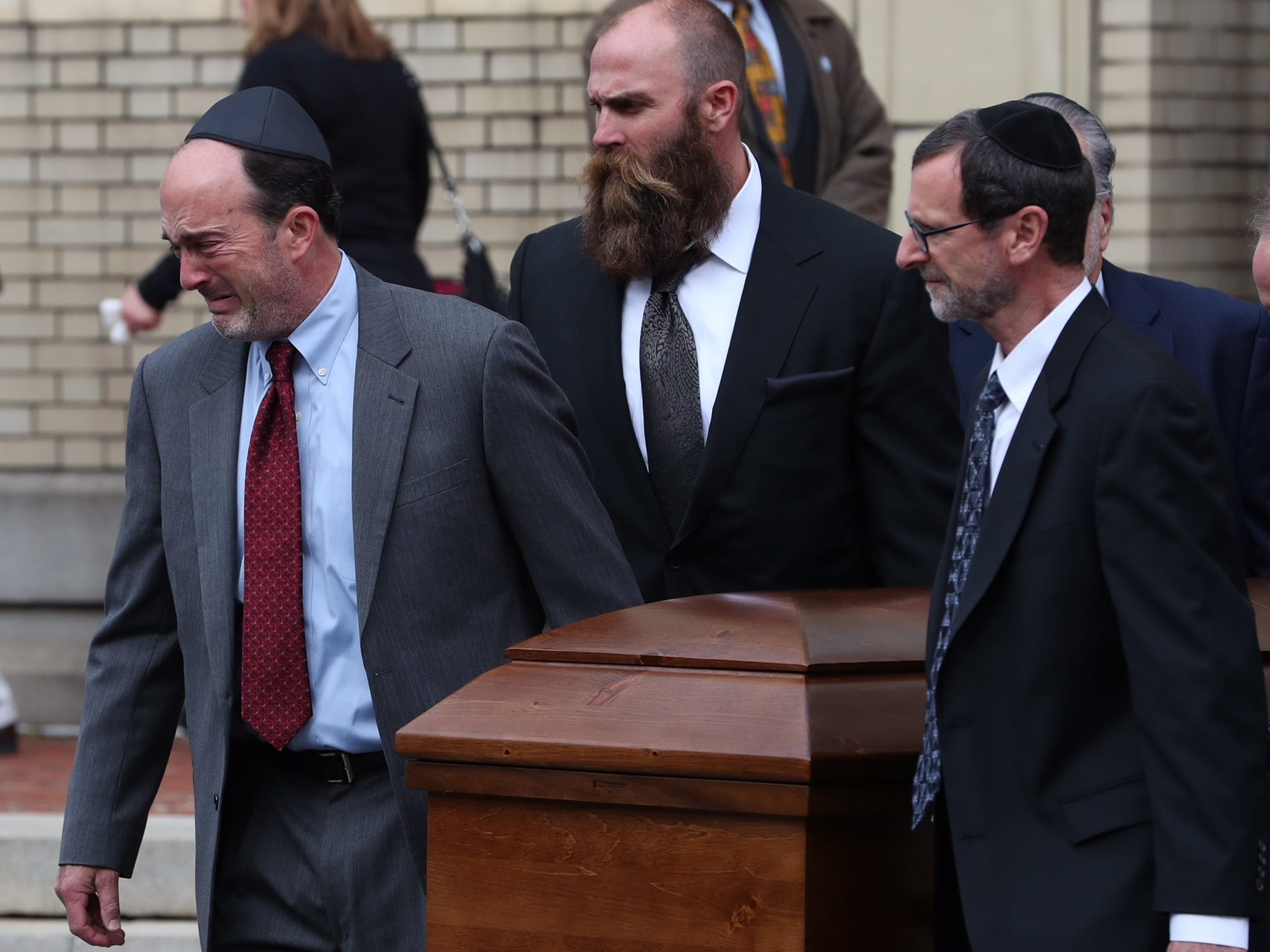 One of the caskets for brothers David and Cecil Rosenthal is carried out of the synagogue at the conclusion of funeral services at the Rodef Shalom Congregation in Pittsburgh, Pa., Tuesday, Oct. 30, 2018.  (Via OlyDrop)