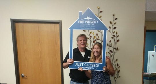 Glen Person and Jill Charles pose after closing on their first home.