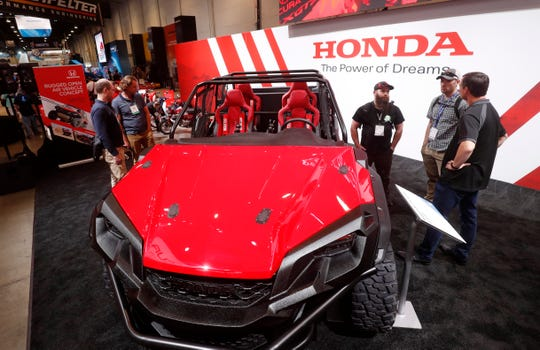 A Rugged Open Air Vehicle Concept car by Honda is displayed during SEMA.