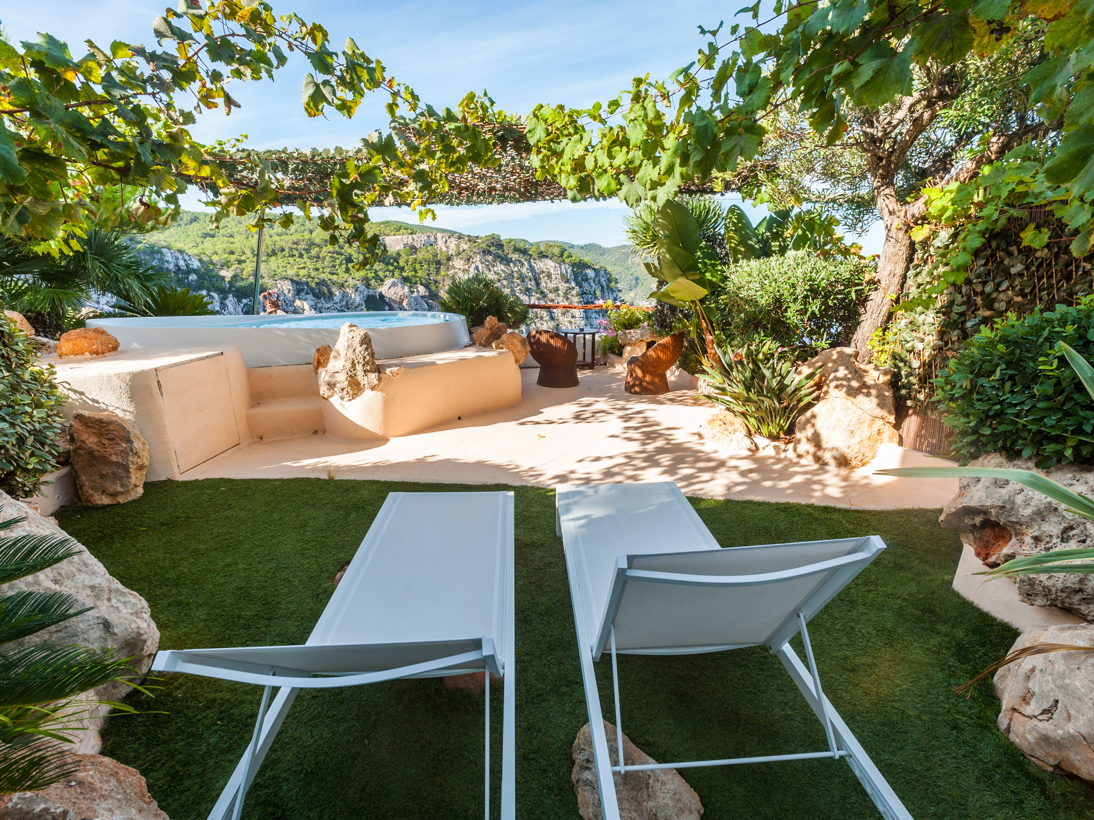 Hacienda Na Xamena, Ibiza: This secluded boutique offers the most spectacular Mediterranean views on Ibiza. Located amid pine tree forests and dramatic rocky cliffs that drop sharply into the sea, the property focuses on quiet luxury and stunning ocean views. All 77 rooms and suites feature furnished balconies or terraces and floor-to-ceiling windows that bring the outdoors in. Eden Rooms add lush, pergola-shaded garden terraces with loungers, wicker chairs and plunge pools.