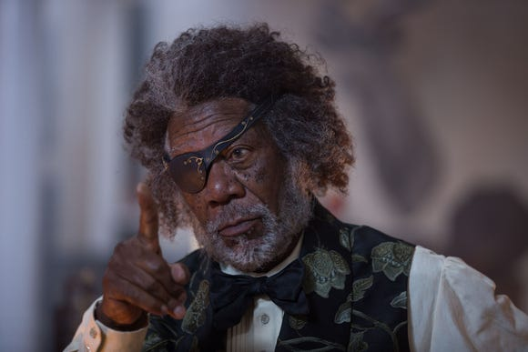 """Drosselmeyer (Morgan Freeman) is a wise old world traveler - and Clara's godfather - in """"The Nutcracker and the Four Realms."""""""