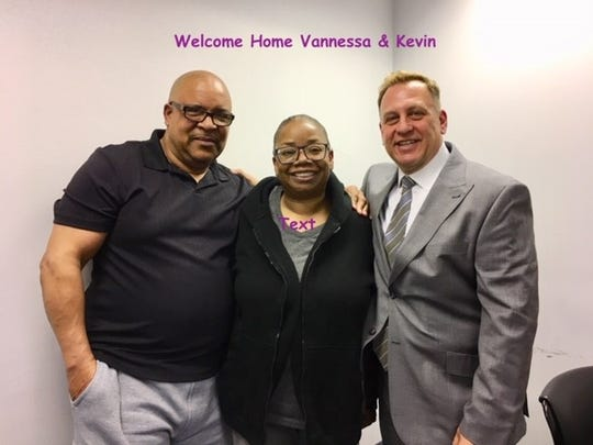 Kevin and Vannessa Blunt pose with their real estate agent, Michael Starrantino, after closing on their house
