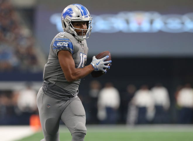 Detroit Lions receiver Golden Tate (15) runs in for a fourth quarter touchdown after a reception against the Dallas Cowboys at AT&T Stadium.