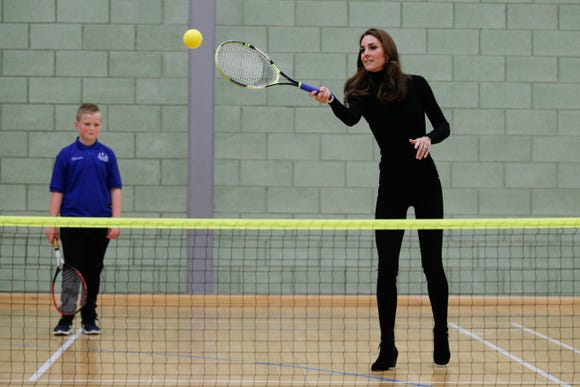 Duchess Kate plays tennis while attending a group training to become Coach Core Essex in London on October 30, 2018.