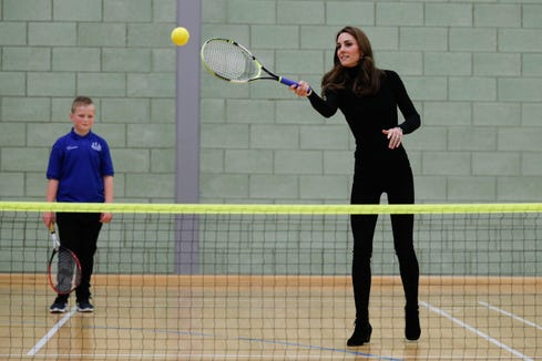 Duchess Kate plays tennis as she joins a session with a group during a visit to the Coach Core Essex apprenticeship scheme in London on Oct. 30, 2018.