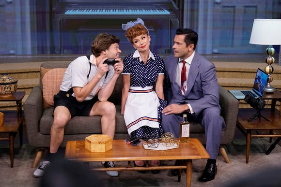 """Kelly Ripa (a dead ringer for Lucille Ball), her husband Mark Consuelos (right, as """"Ricky""""/Desi Arnaz) and Ryan Seacrest (Little Ricky) combine forces for a very special 2018 reboot of """"I Love Lucy"""" as part of """"Live's Best Halloween Show Ever: the ReBOOOOt."""""""