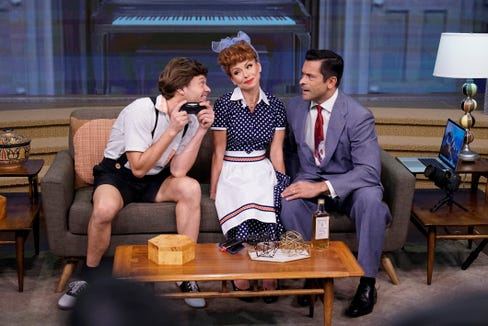 "Kelly Ripa (a dead ringer for Lucille Ball), her husband Mark Consuelos (right, as ""Ricky""/Desi Arnaz) and Ryan Seacrest (Little Ricky) combine forces for a very special 2018 reboot of ""I Love Lucy"" as part of ""Live's Best Halloween Show Ever: the ReBOOOOt."""