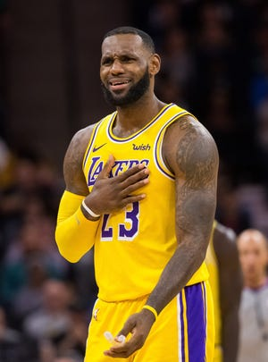 Lakers forward LeBron James reacts to a call in the third quarter against Minnesota Timberwolves at Target Center.
