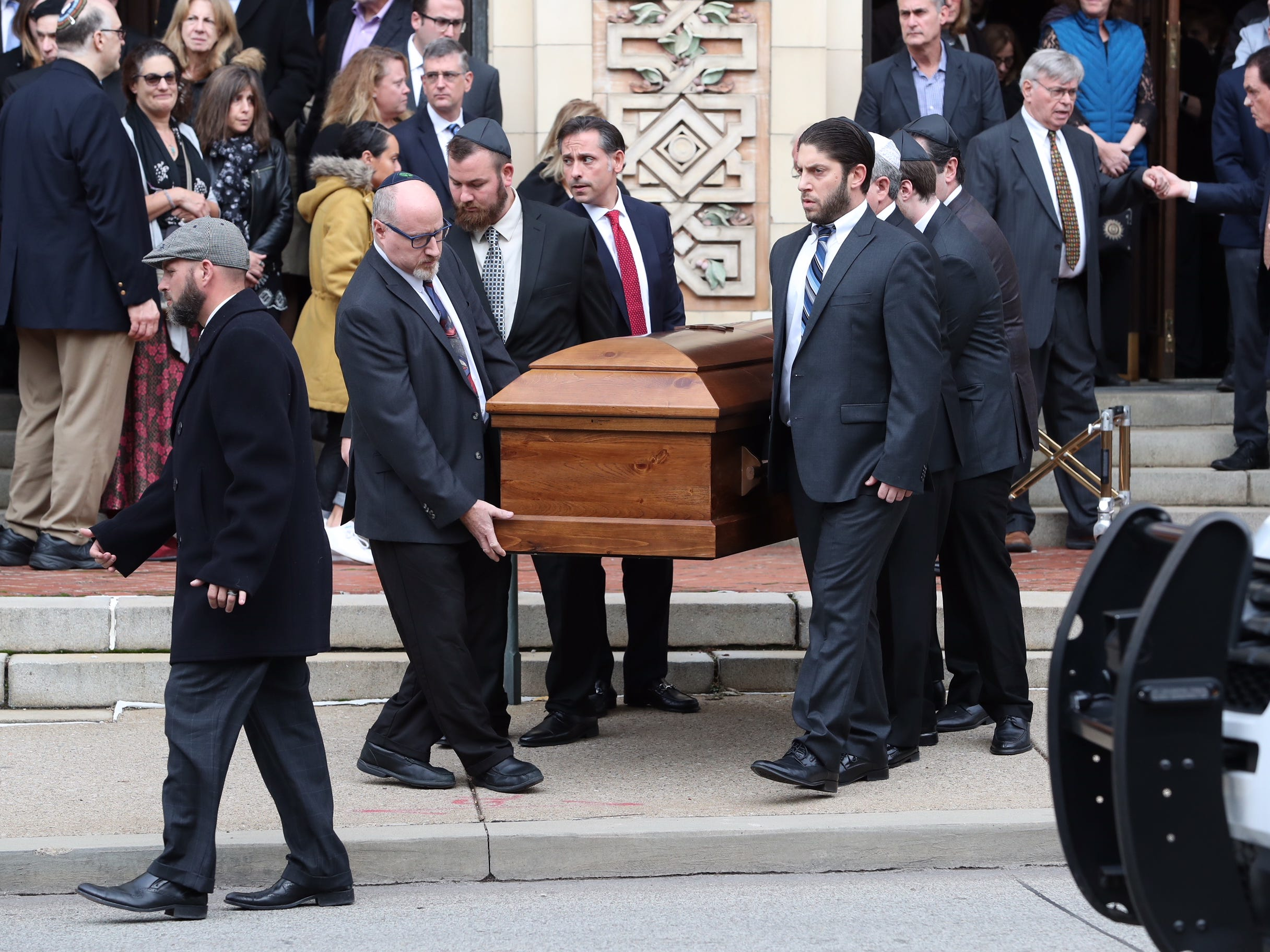 One of the caskets for brothers David and Cecil Rosenthal is carried out of the synagogue at the conclusion of funeral services at the Rodef Shalom Congregation in Pittsburgh, Pa., Tuesday, Oct. 30, 2018.