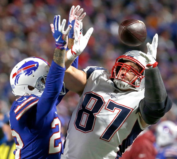 New England Patriots tight end Rob Gronkowski (87) makes a catch while being defended by Buffalo Bills defensive back Phillip Gaines (28) during the second half at New Era Field.