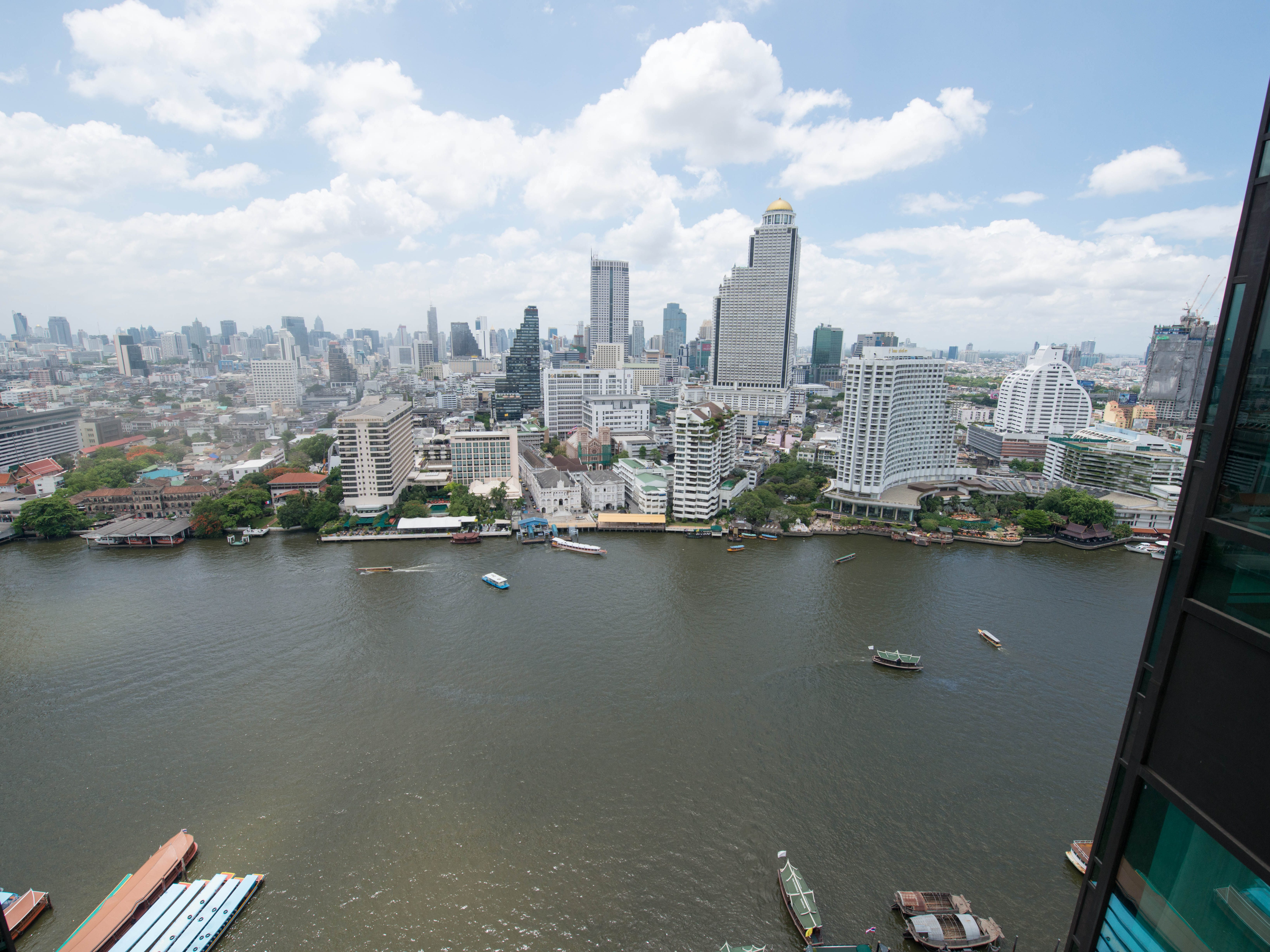 The Peninsula Bangkok: A location on the west side of the Chao Phraya River, across from Bangkok's main attractions, could be considered a drawback, as it means getting to Bangkok proper by road is arduous. On the plus side, the position guarantees unobstructed views of the river and the dramatic Bangkok skyline. (Plus, the hotel runs a free shuttle boat on the river, which drops guests off at the Saphan Taksin pier.) All rooms benefit from this perspective, and some, like the Grand Balcony Room, feature outdoor balcony seating – and stunning views.