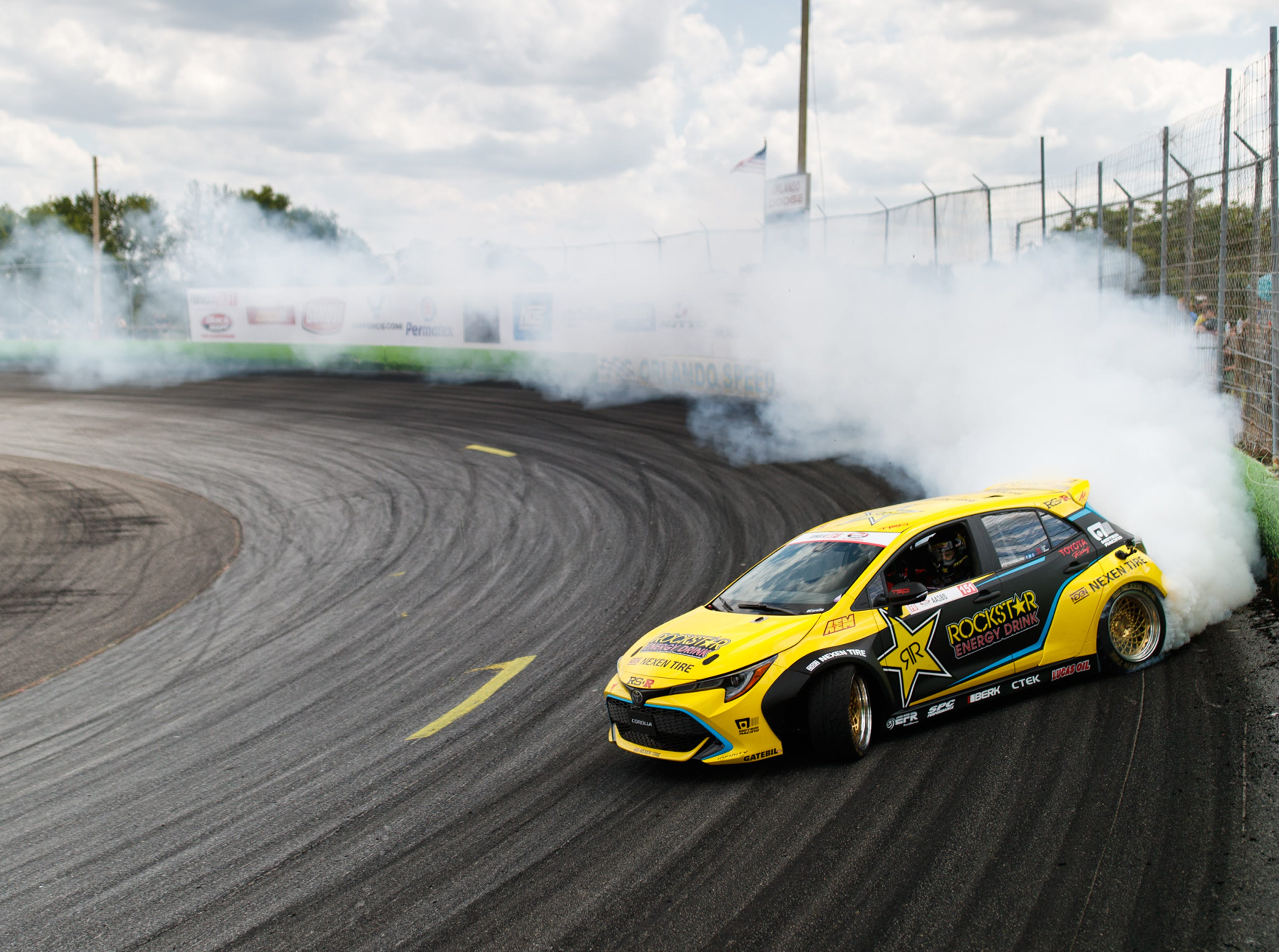 A Toyota Corolla hatchback becomes the Rockstar drift car at the SEMA aftermarket parts trade show in Las Vegas