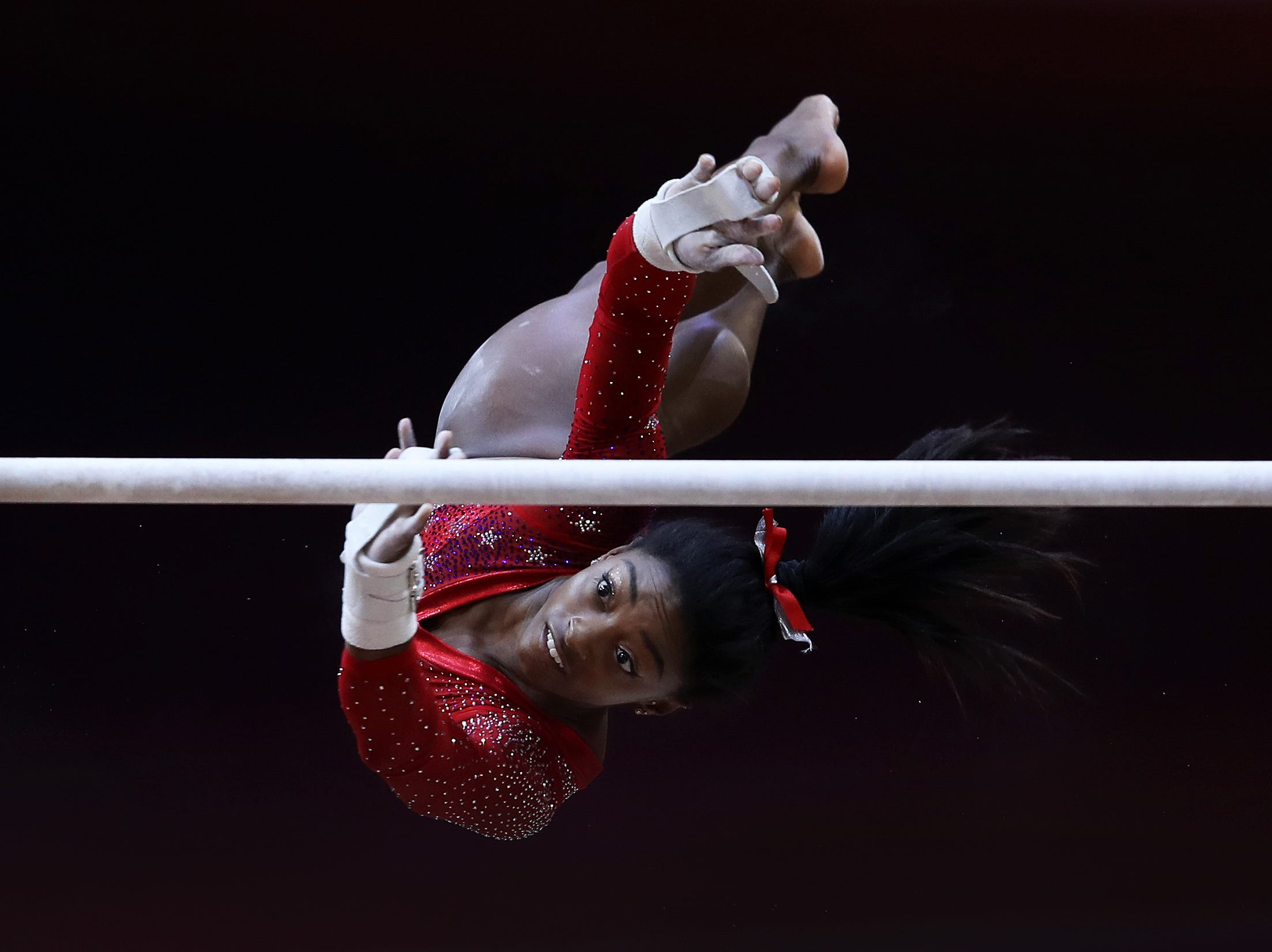 Simone Biles competes during the uneven bars at the 2018 FIG Artistic Gymnastics Championships at Aspire Dome on Oct, 30 in Doha, Qatar.