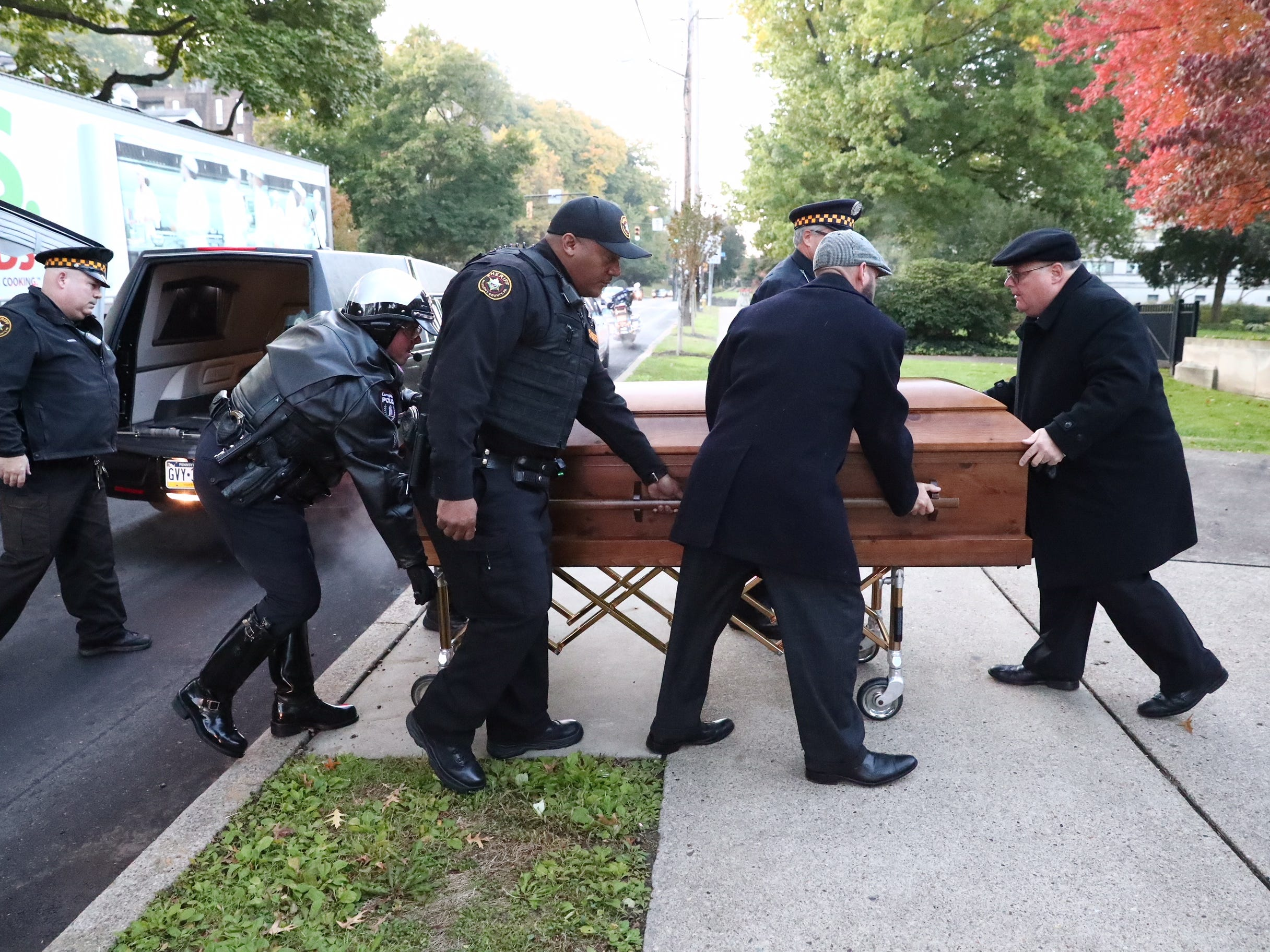 One of the caskets for brothers David and Cecil Rosenthal arrives at Rodef Shalom Synagogue, Tuesday, Oct. 30, 2018, in Pittsburgh.