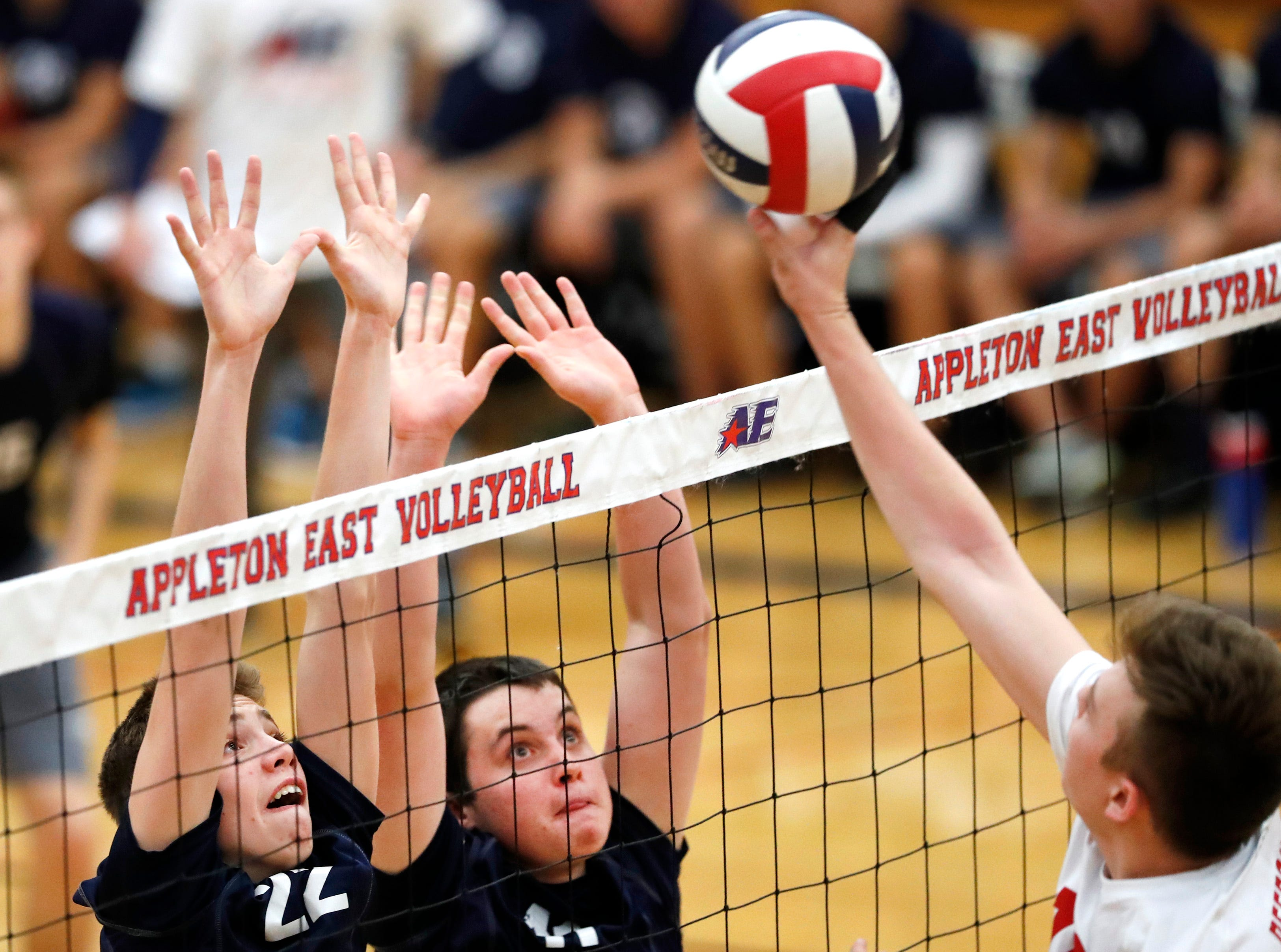 Appleton East's Drew Carpenter and Dylan Timmer jump for a block during their match against Neenah Tuesday, Oct. 23, 2018, in Appleton, Wis.Danny Damiani/USA TODAY NETWORK-Wisconsin
