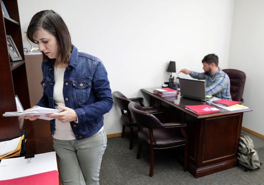 World Relief Fox Valley immigration specialist Ashley Hill and immigration manager Phil Stoffel work in their office in Appleton.